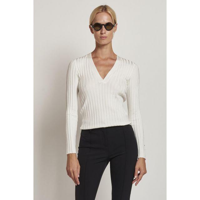 white ribbed V-neck sweater