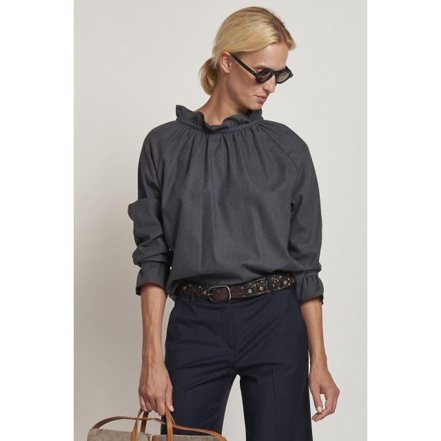 gray shirt with ruffled collar