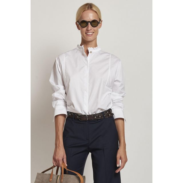 white shirt with ruffled collar