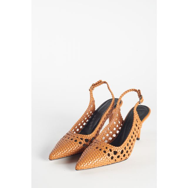 Shoes with perforated heels open behind