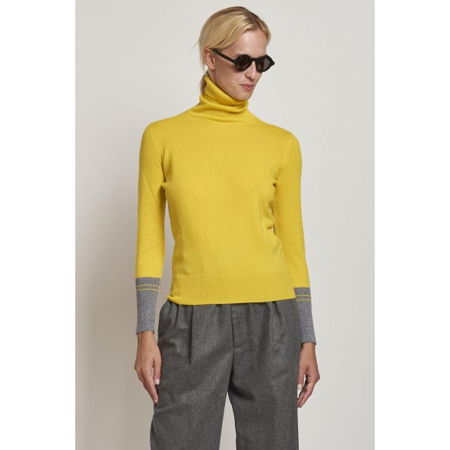 yellow turtleneck with gray cuffs