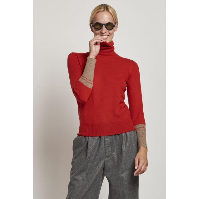 red turtleneck with camel cuffs