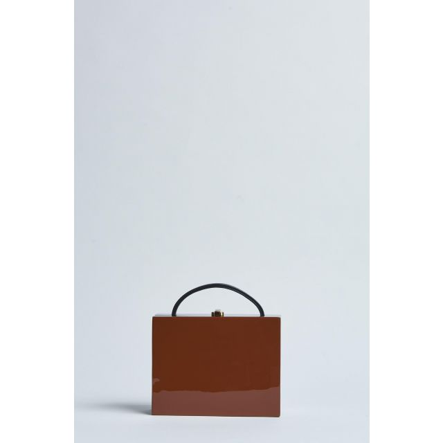 bag in light brown lacquered wood