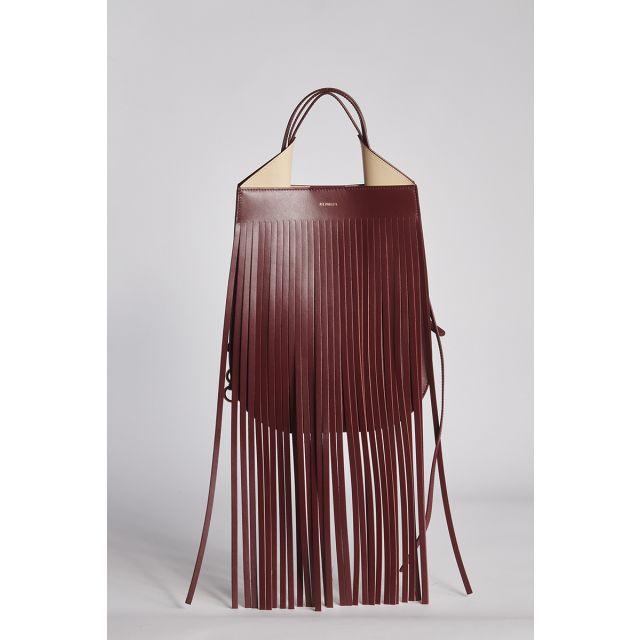 Shoulder bag in burgundy leather with fringes