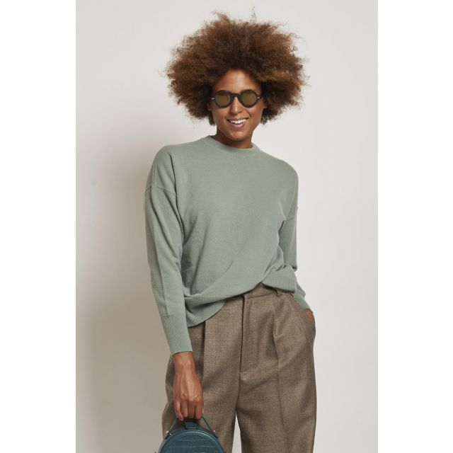 round neck sweater over green