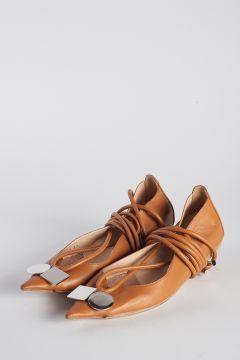 Ballerine intrecciate su caviglie