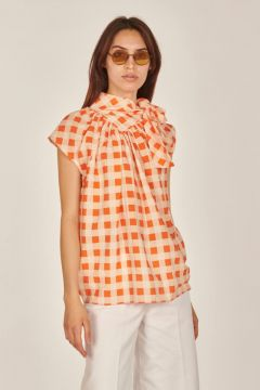 White and orange checked top