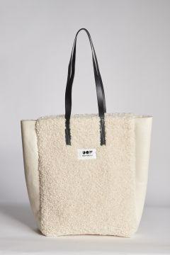 White patent leather bag plus fur