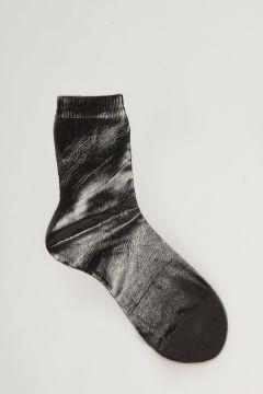 calza nera effetto metallizzato