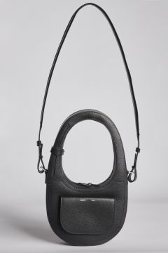 Oval shoulder bag with front pocket