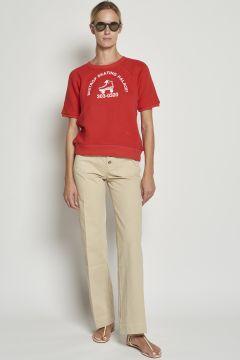 Pantaloni beige in cotone con bottoni