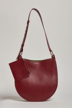 red leather bag with colored bellows detail