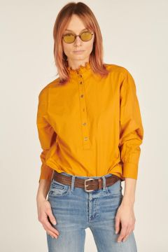 Orange Louise shirt with ruffles on the collar