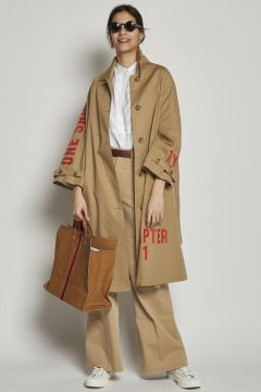 Beige coat with red writing