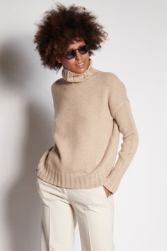 Beige turtleneck with ribbed cuffs