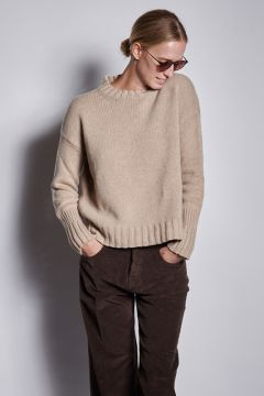 Beige sweater with ribbed cuffs