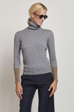 gray turtleneck with camel cuffs