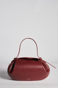 Burgundy oval leather bag