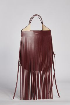 Shoulder bag in burgundy leather with fringes