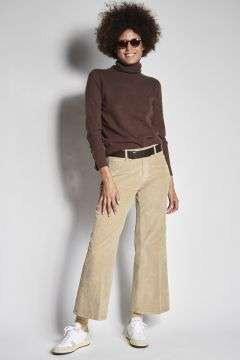 Flared beige trousers in smooth velvet