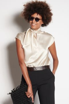 Ivory sleeveless shirt with scarf