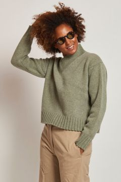 green v-neck wool sweater