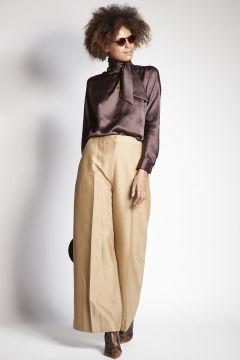 Pantaloni beige lucidi
