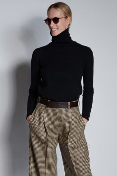 Black turtleneck with buttons on the cuffs