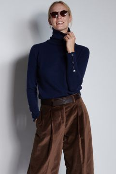 Blue turtleneck with buttons on the cuffs