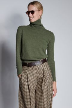 Green turtleneck with buttons on the cuffs