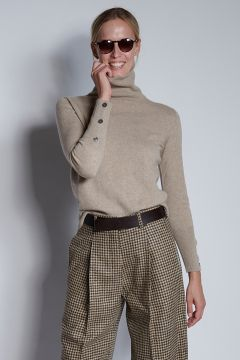 Beige turtleneck with buttons on the cuffs