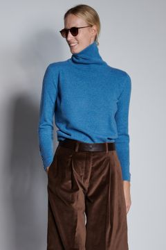 Light blue turtleneck with buttons on the cuffs