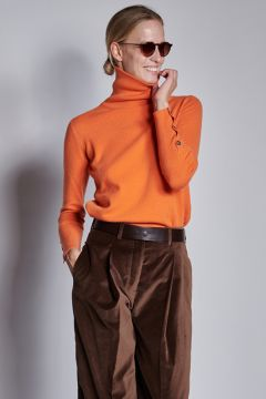 Orange turtleneck with buttons on the cuffs