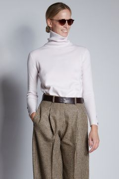 Ivory turtleneck with buttons on the cuffs