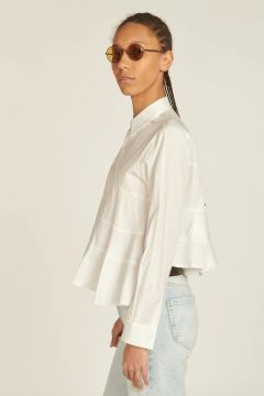 white flared shirt with cuts