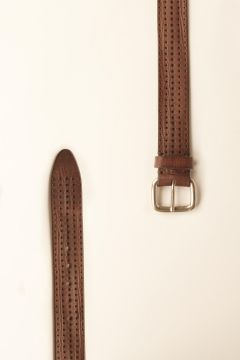 Brown leather belt with perforations