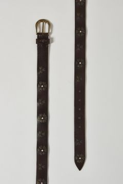 dark brown leather belt with flower-shaped metal inserts