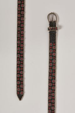 brown leather belt with coral-colored metal inserts