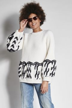 White sweater with black embroidery