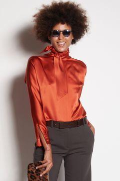 Orange long-sleeved shirt with scarf